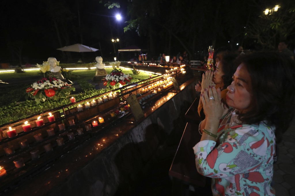 In this Friday, Oct. 18, 2019, photo, Catholic devotees pray at the seven martyrs cemetery during the 30th anniversary of the beatification of seven m...
