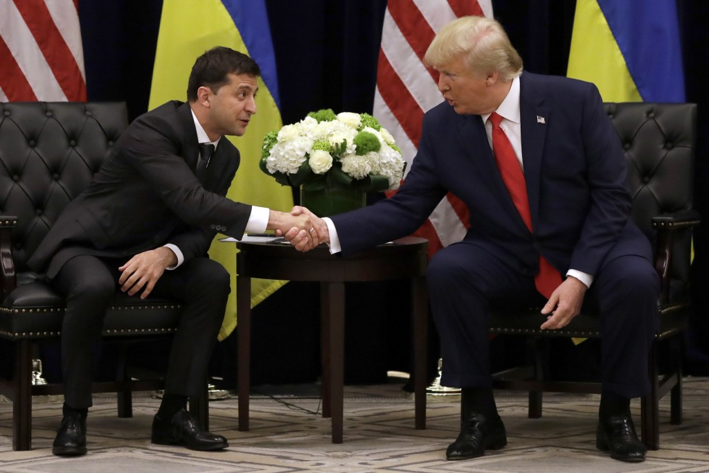 FILE - In this Sept. 25, 2019, file photo, President Donald Trump meets with Ukrainian President Volodymyr Zelenskiy at the InterContinental Barclay N...