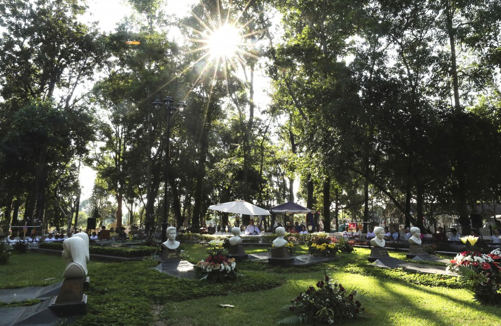 In this Friday, Oct. 18, 2019, photo, Catholic devotees pray at the Blessed Martyrs for Christians cemetery during the 30th anniversary of the beatifi...