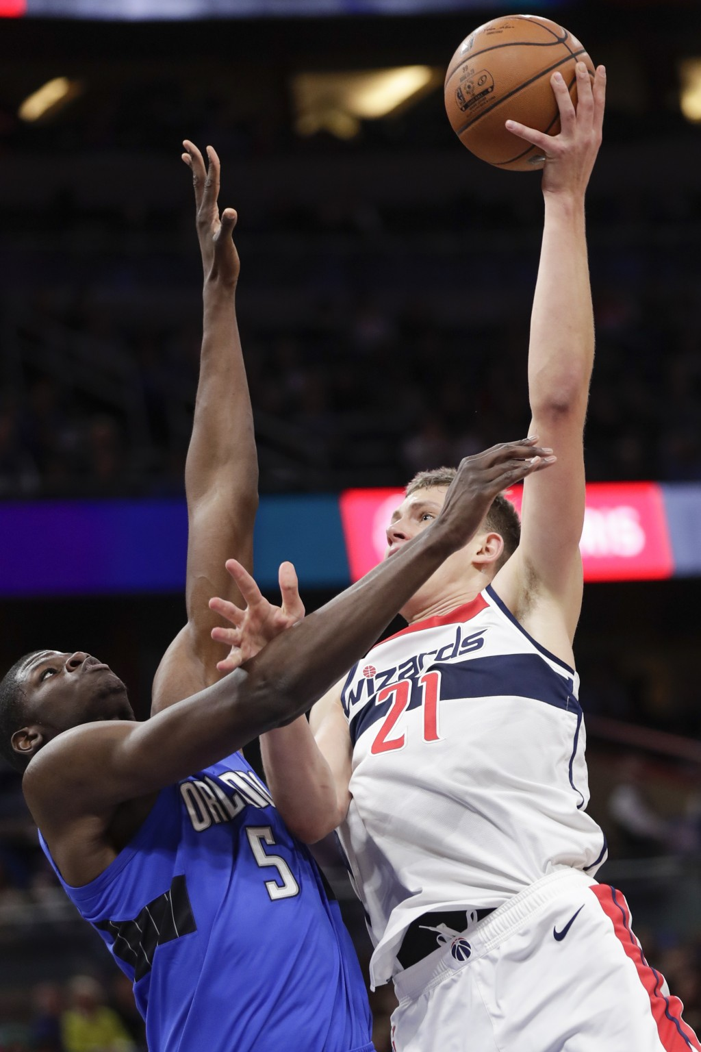 Washington Wizards' Moritz Wagner (21) takes a shot over Orlando Magic's Mo Bamba (5) during the first half of an NBA basketball game, Sunday, Nov. 17...