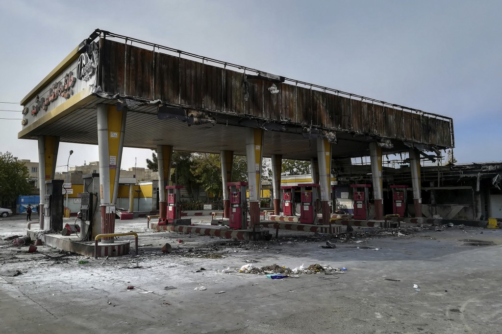 This photo released by the Iranian Students' News Agency, ISNA, shows a gas station that was burned during protests that followed authorities' decisio...