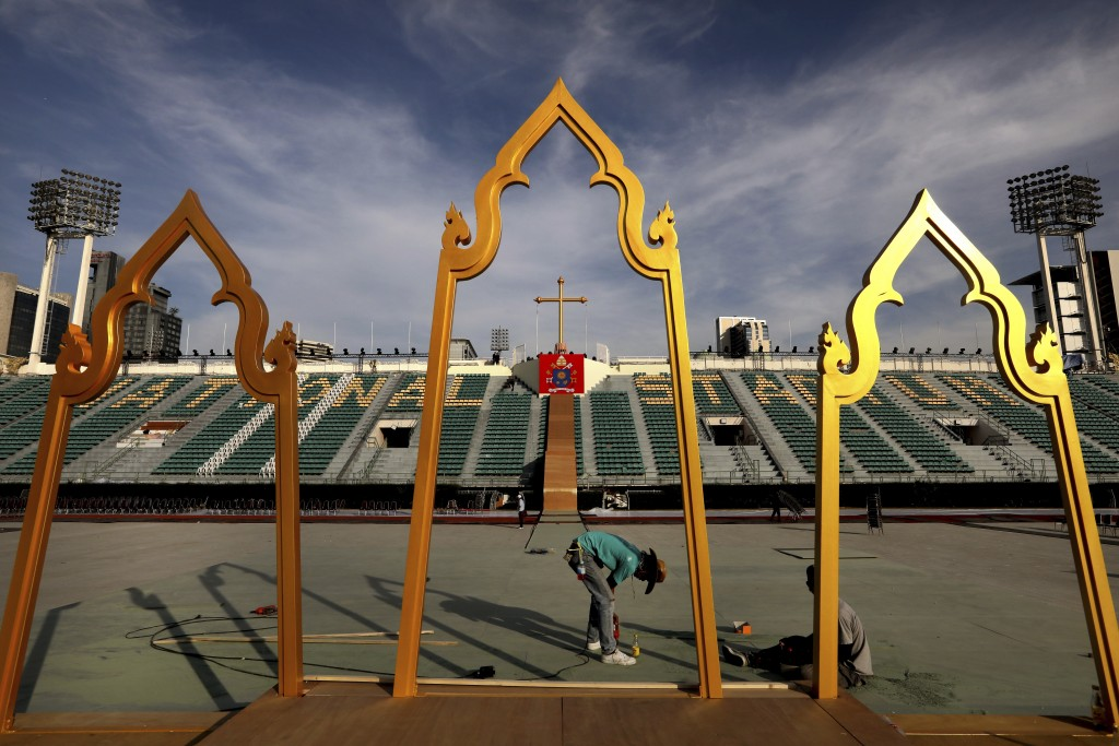 Workers prepare the stage at the National stadium from where Pope Francis is scheduled to  conduct holy mass on Thursday, in Bangkok, Thailand, Tuesda...