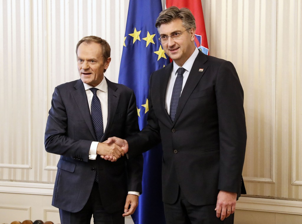 President of the European Council Donald Tusk, left, is welcomed by Croatia's prime minister Andrej Plenkovic in Zagreb, Croatia, Tuesday, Nov. 19, 20...