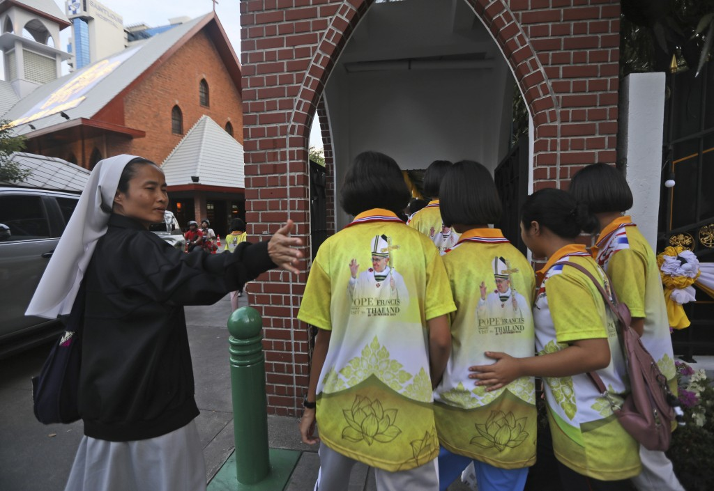 A nun guides her students wearing Pope Francis t-shirt inside a convent in Bangkok, Thailand, Tuesday, Nov. 19, 2019. Pope Francis arrives in Thailand...
