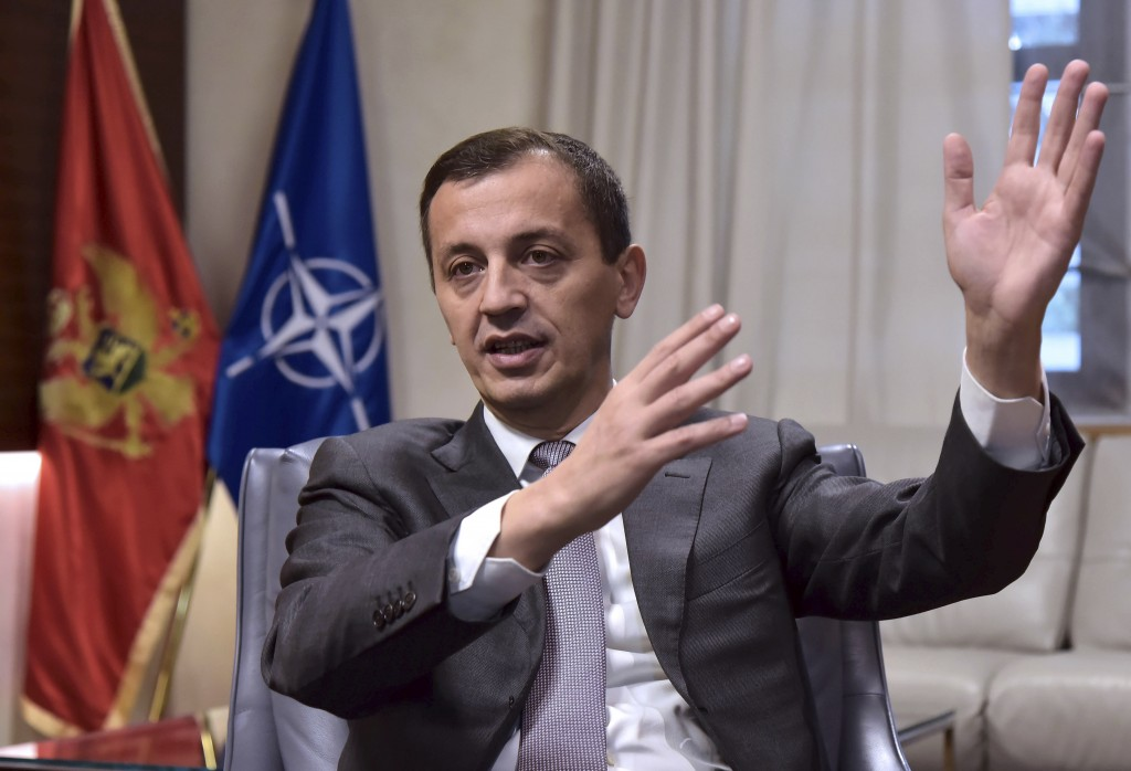 In this photo taken Monday, Nov. 11, 2019, Montenegrin Defense Minister Predrag Boskovic speaks and gestures during an interview with The Associated P...