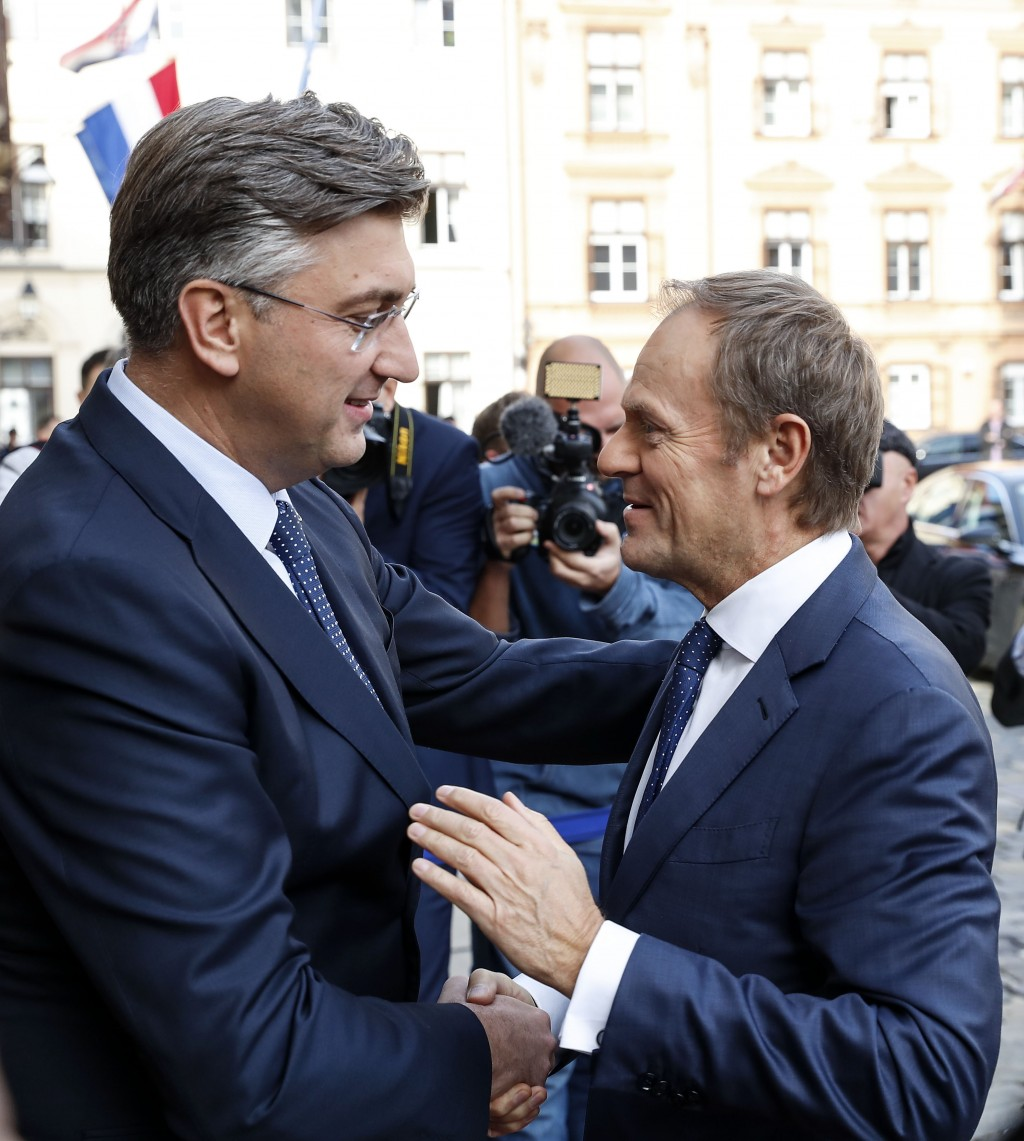 President of the European Council Donald Tusk, right, is welcomed by Croatia's prime minister Andrej Plenkovic in Zagreb, Croatia, Tuesday, Nov. 19, 2...