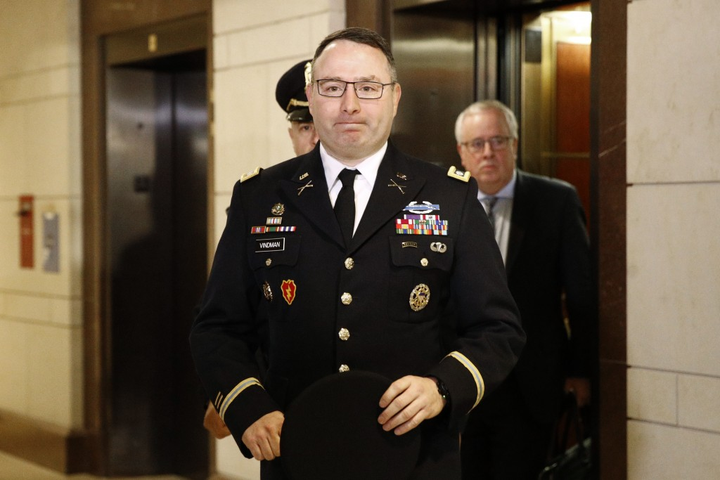 FILE - In this Oct. 29, 2019, file photo, Army Lt. Col. Alexander Vindman, a military officer at the National Security Council, center, arrives on Cap...