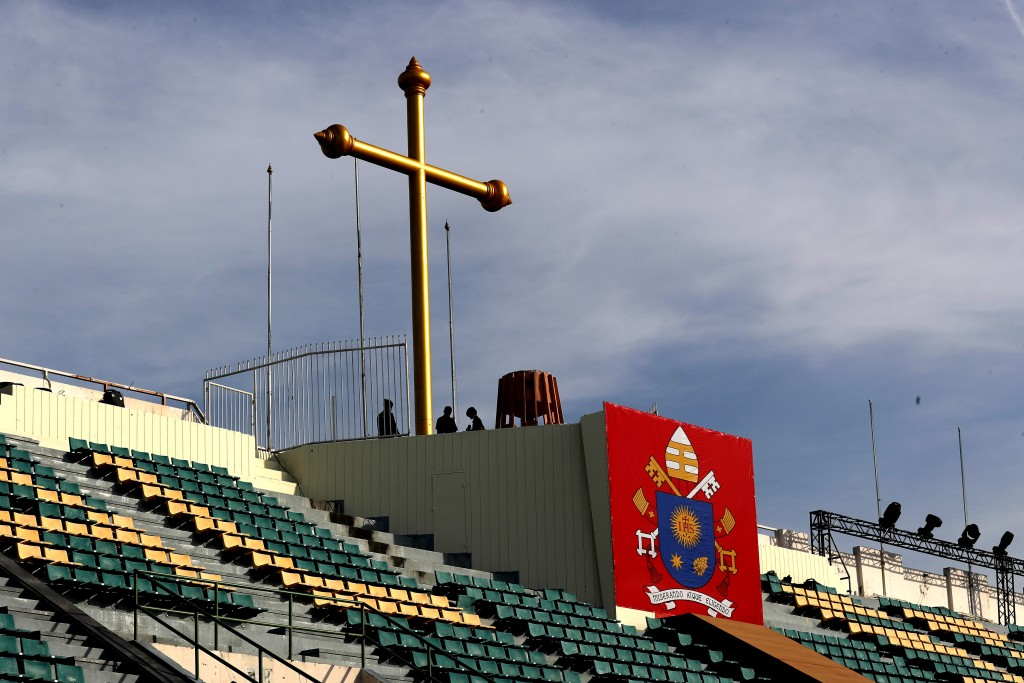 Workers prepare the stage at the National stadium from where Pope Francis is scheduled to conduct holy mass on Thursday, in Bangkok, Thailand, Tuesday...