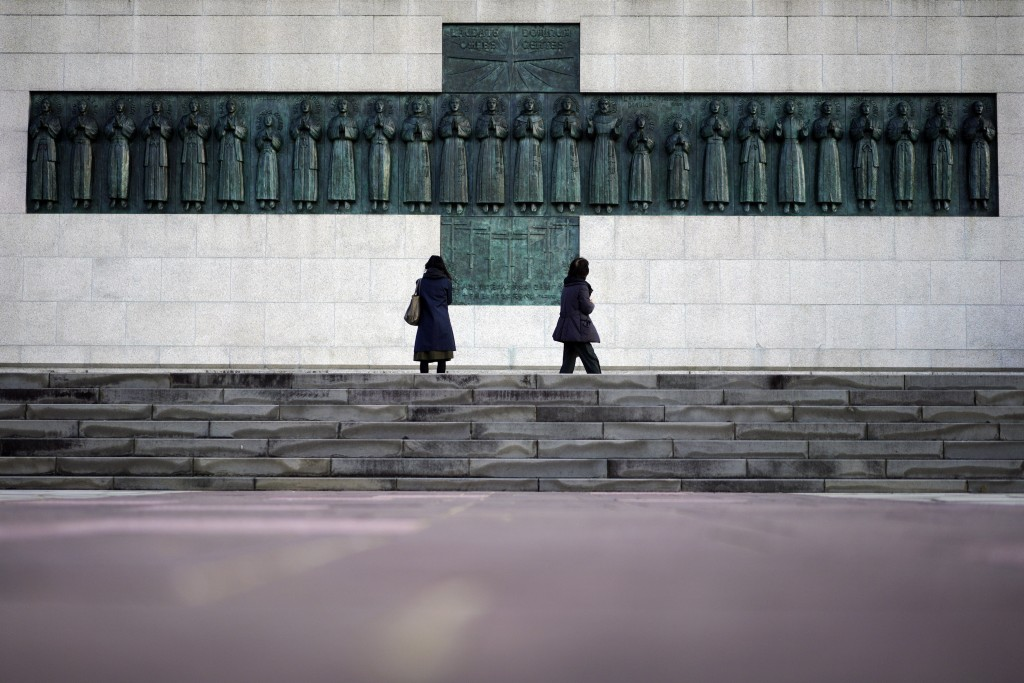 In this Nov. 17, 2019, photo, people visit the Twenty-Six Martyrs Monument in Nagasaki, southern Japan. Pope Francis will start his first official vis...
