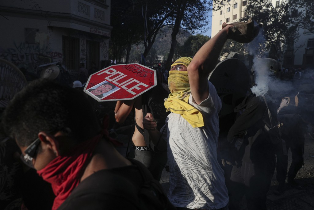 Anti-government protesters clash with police in Santiago, Chile, Monday, Nov. 18, 2019. According to the Medical College of Chile at least 230 people ...