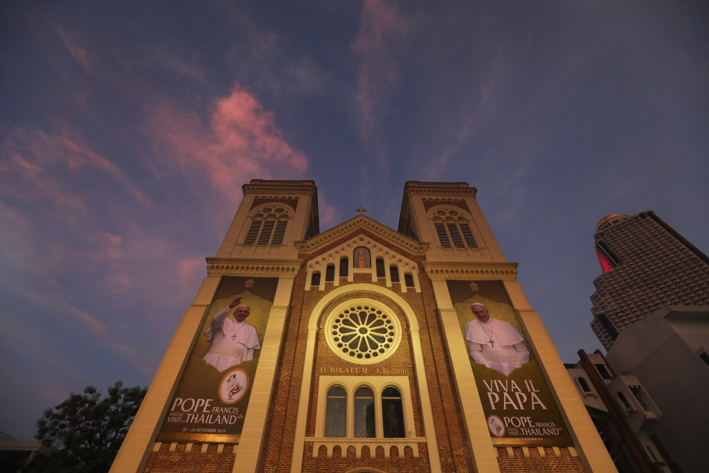 Huge posters of Pope Francis poster are displayed at the entrance of Assumption Cathedral in Bangkok, Thailand, Tuesday, Nov. 19, 2019. Pope Francis a...