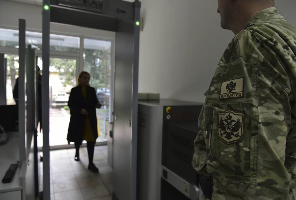 In this photo taken Monday, Nov. 11, 2019, a guard stands at the entrance of the Montenegrin Defense Ministry in Montenegro's capital Podgorica. Deplo...