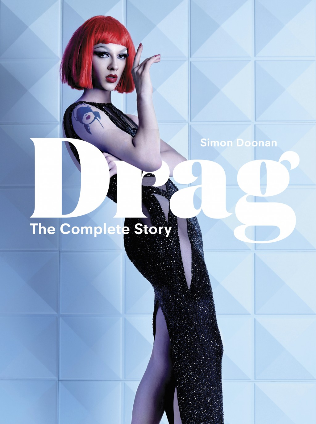 "This cover image released by Laurence King Publishing shows ""Drag"" The Complete Story"" by Simon Doonan. Doonan, the creative ambassador for Barney's N..."