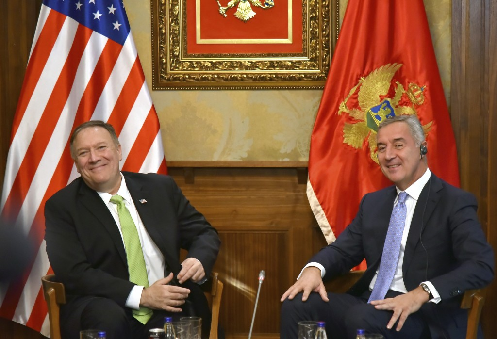 In this photo taken Friday, Oct. 4, 2019, United States Secretary of State Mike Pompeo, left, speaks with Montenegro President Milo Djukanovic, in Pod...