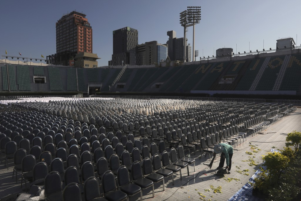 A worker cleans the area inside national stadium where Pope Francis is scheduled to conduct holy mass on Thursday, in Thailand, Wednesday, Nov. 20, 20...