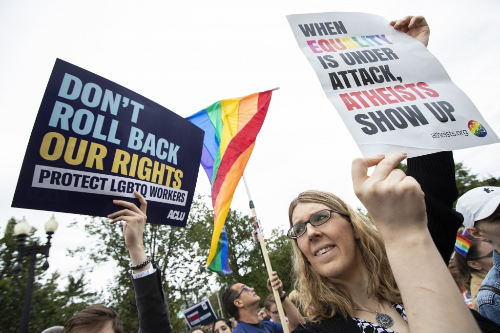 Transgender woman Alison Gill from Maryland, joins LGBT supporters in front of the U.S. Supreme Court, Tuesday, Oct. 8, 2019, in Washington. The Supre...