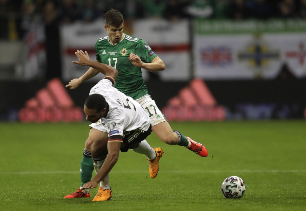 Germany's Jonathan Tah, front, fights for the ball with Northern Ireland's Paddy McNair during a Group C soccer qualifying match between Germany and N...