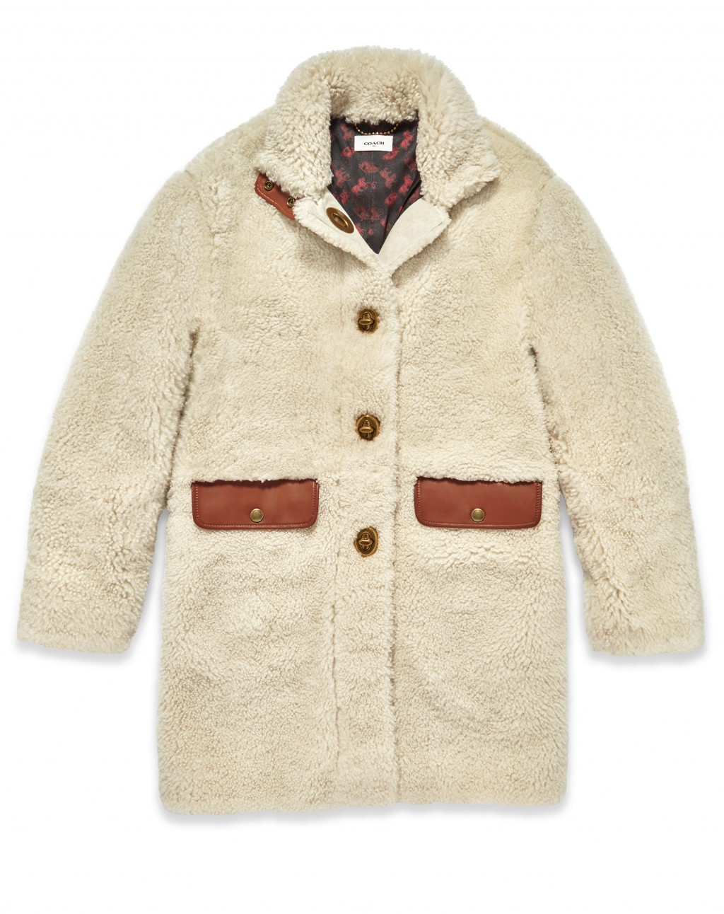 This photo shows a Coach shearling coat in cream. From tablescapes to apparel, the gift possibilities in white are endless for the holidays. (AP Photo...