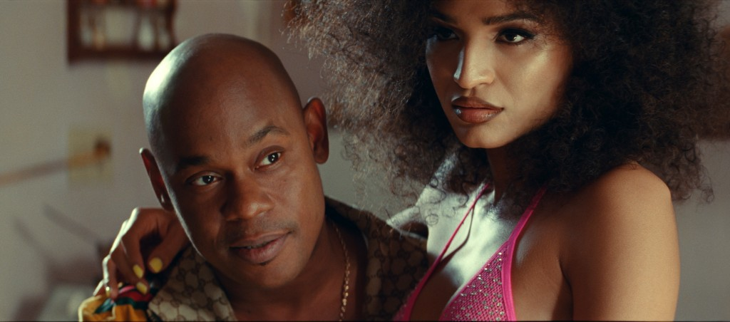 """This image released by Universal Pictures shows Bokeem Woodbine, left, and Indya Moore in a scene from the film """"Queen & Slim,"""" directed by Melina Mat..."""