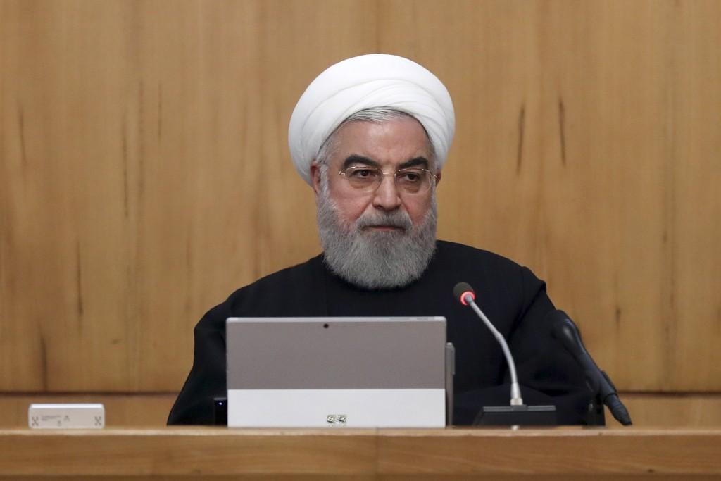 In this photo released by the official website of the Office of the Iranian Presidency, President Hassan Rouhani speaks in a cabinet meeting in Tehran...