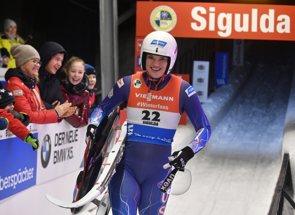 FILE - In this Saturday, Jan. 12, 2019 file photo, Summer Britcher of United States smiles after she placed third of a women's race at the Luge World ...