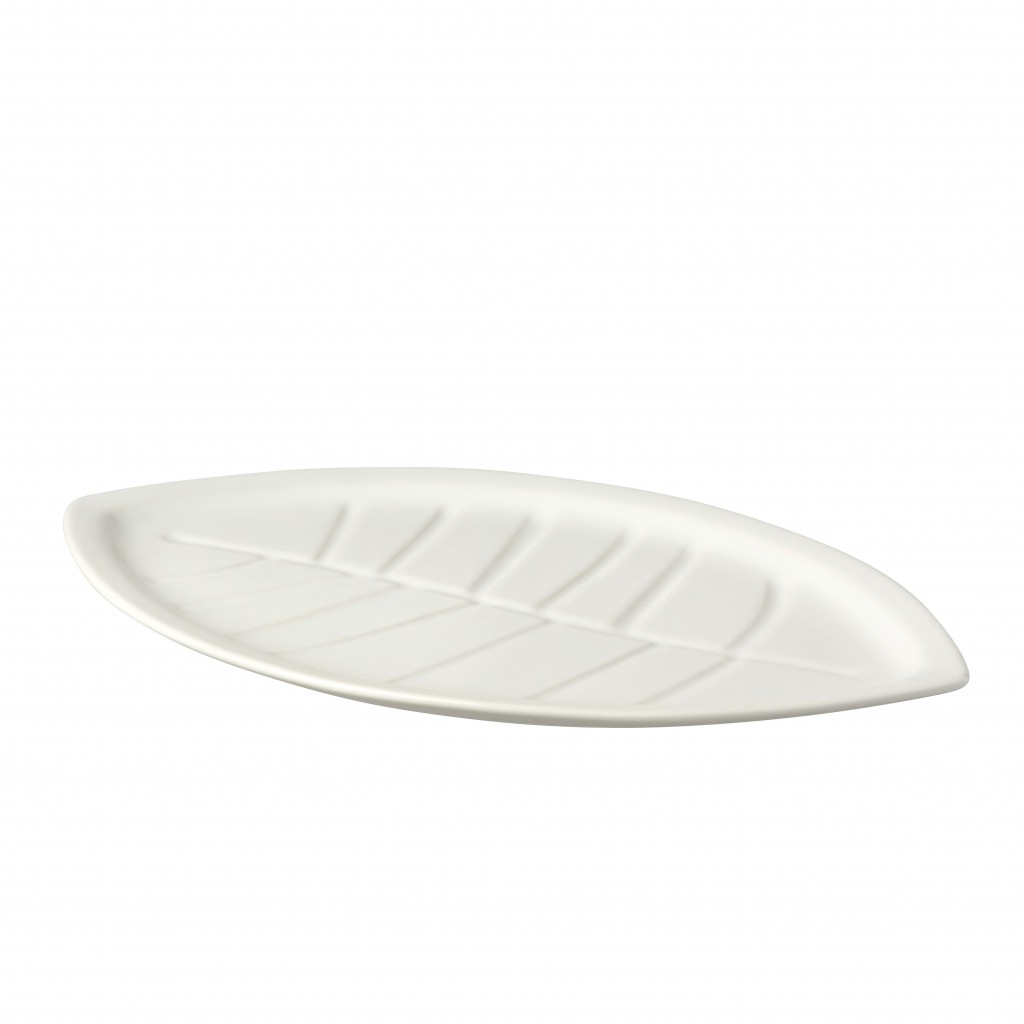 This photo shows the leaf-shaped side plate in the Ikea Vinterfest collection. From tablescapes to apparel, the gift possibilities in white are endles...