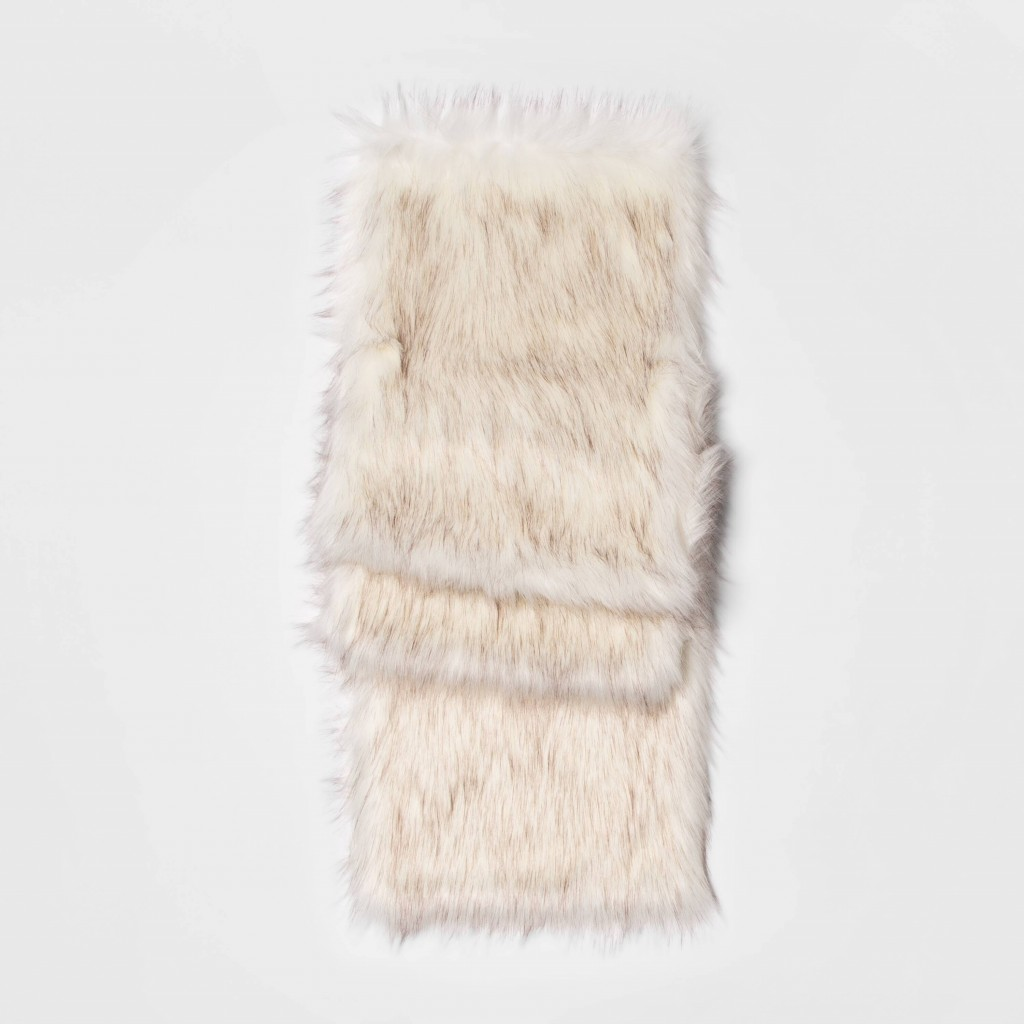 This photo shows the Threshold faux fur table runner. From tablescapes to apparel, the gift possibilities in white are endless for the holidays. (AP P...