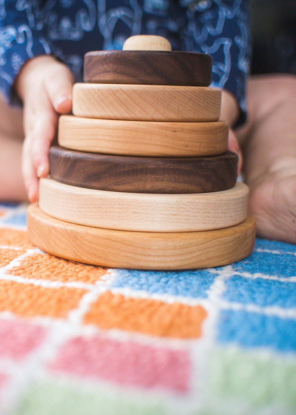 This image released by Etsy shows  wooden circle stackers for infants and toddlers by Etsy seller, SouthBendWorks. (Etsy via AP)