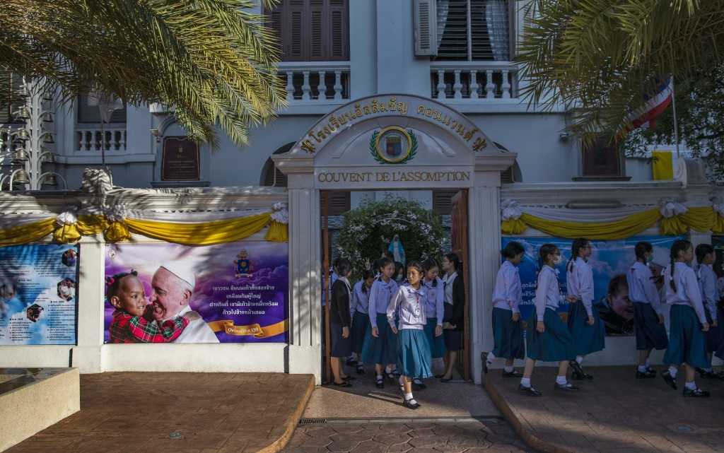 School children walk at Assumption convent, decorated with posters of Pope Francis in Bangkok, Thailand, Wednesday, Nov. 20, 2019. Pope Francis arrive...