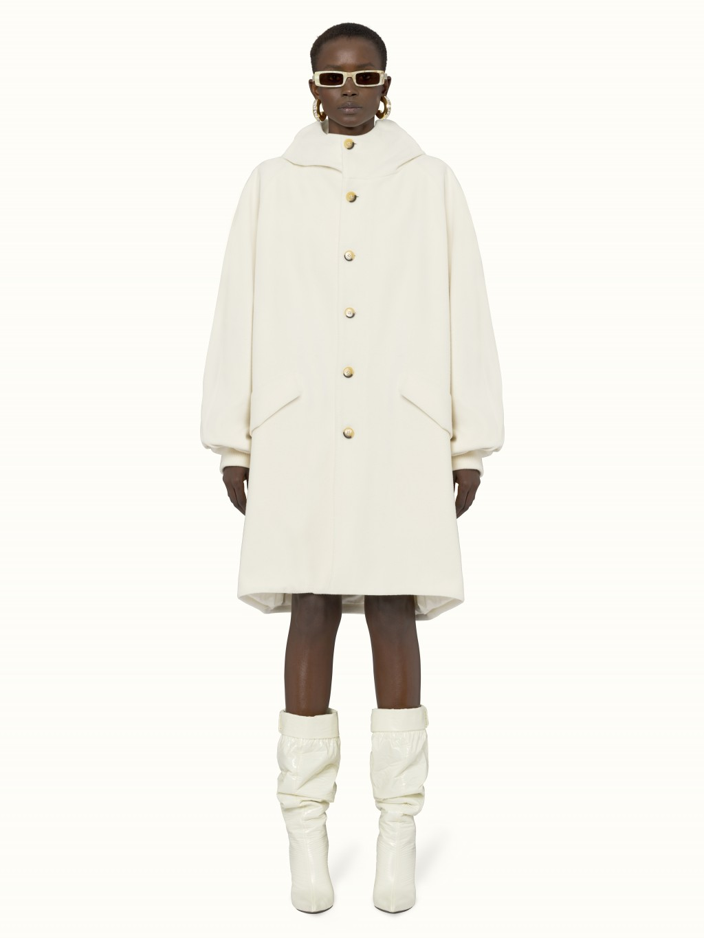 This photo shows the Fenty Parka Oversize Cocoon coat in cream. From tablescapes to apparel, the gift possibilities in white are endless for the holid...