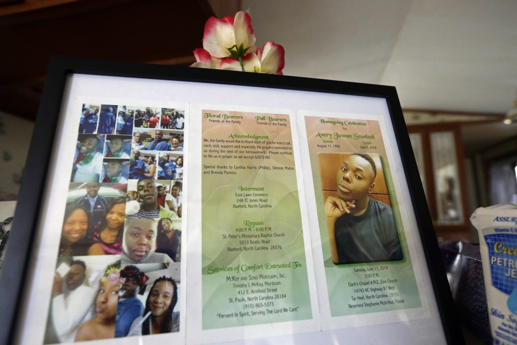 In this photo taken Tuesday, Aug. 6, 2019, a framed copy of Avery Scurlock's memorial is shown in Avery's mother Brenda Scurlock's home in Lumber Brid...