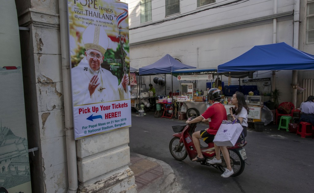 A poster of Pope Francis is displayed in a street corner in Bangkok, Thailand, Wednesday, Nov. 20, 2019. Pope Francis arrives in Thailand on Wednesday...