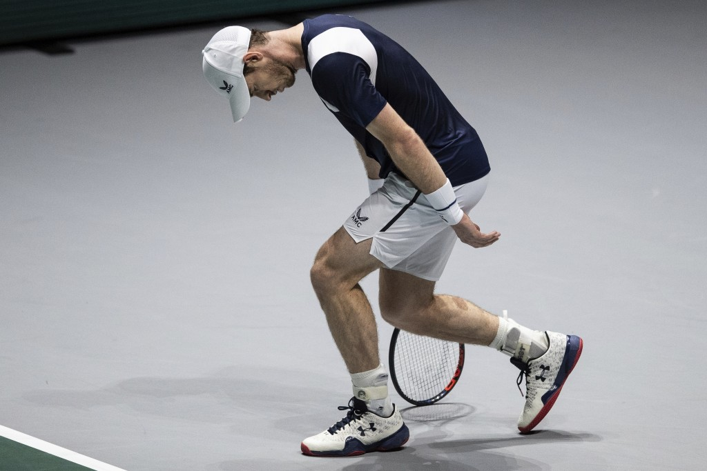Great Britain's Andy Murray misses a point during the Davis Cup tennis match against Netherlands' Tallon Griekspoor in Madrid, Spain, Wednesday, Nov. ...