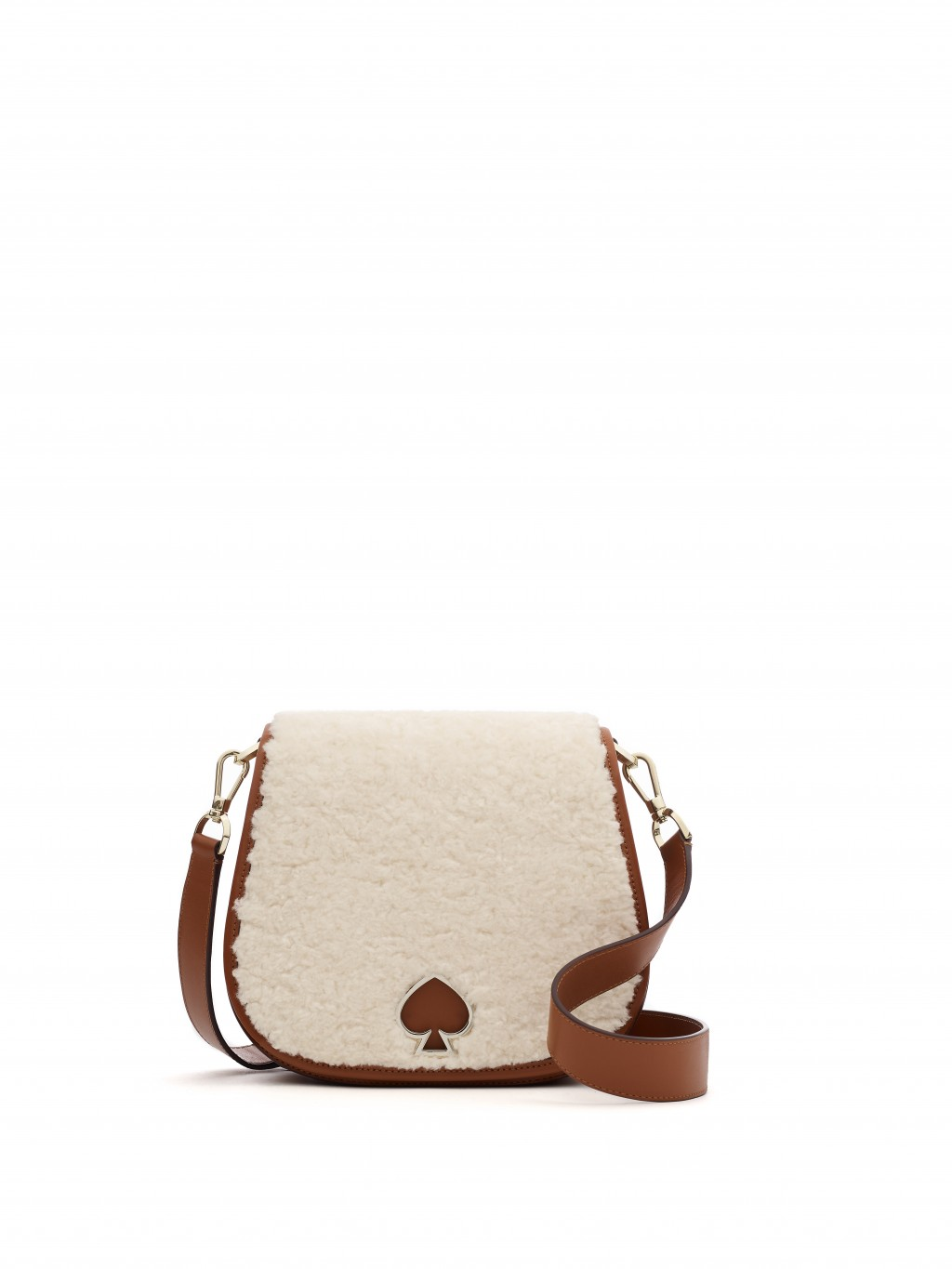 This photo shows the Kate Spade Suzy large saddle bag in shearling. From tablescapes to apparel, the gift possibilities in white are endless for the h...