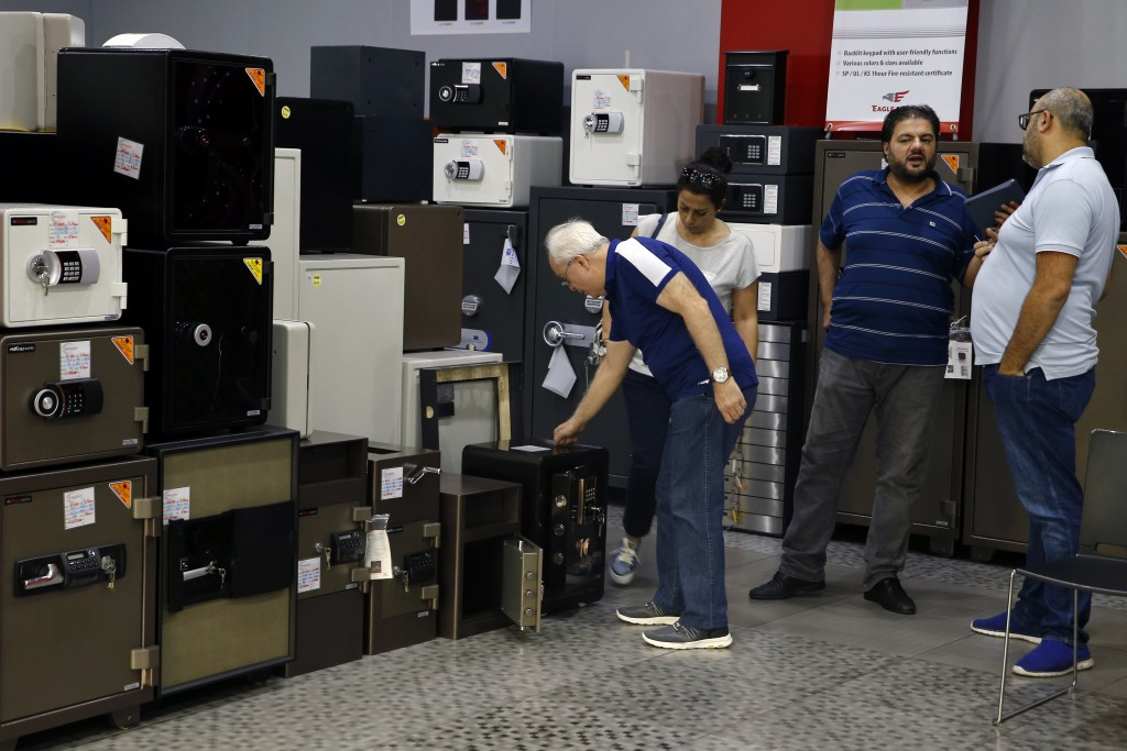 Customers checks the safes for sale at the Shehab Security shop in Beirut, Lebanon, Wednesday, Nov. 20, 2019. Lebanon's worsening financial crisis has...