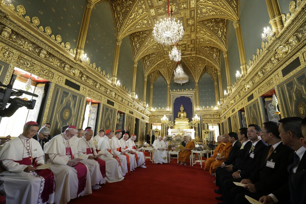 Pope Francis, center left, visits the Supreme Buddhist Patriarch at Was Ratchabophit Sathit Maha Simaram Temple, Thursday, Nov. 21, 2019, in Bangkok, ...