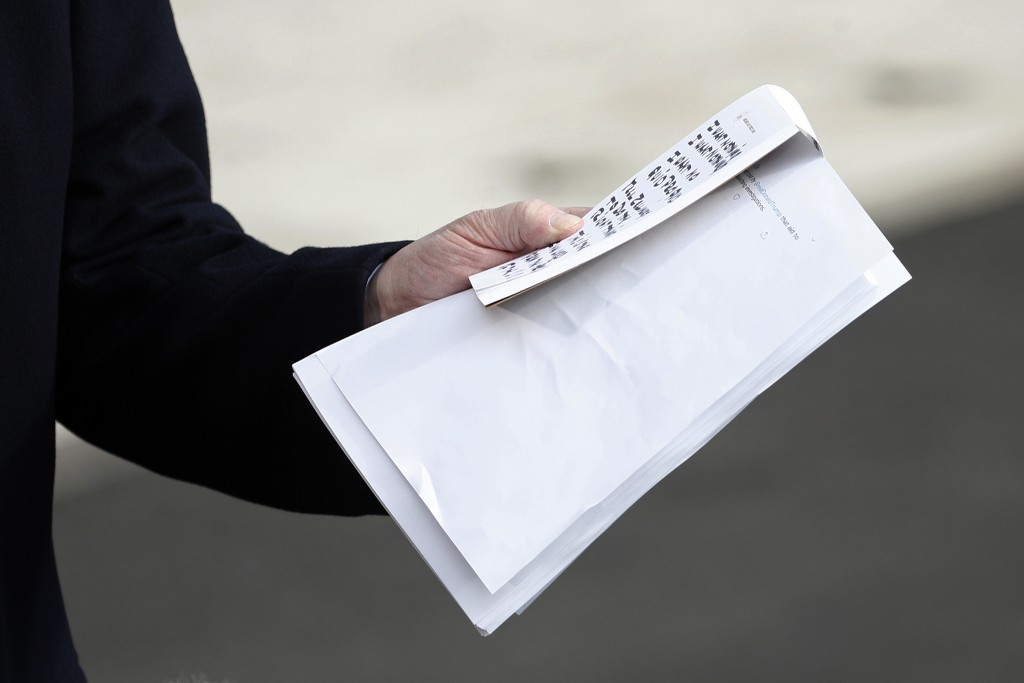 President Donald Trump holds notes and papers as he talks to the media on his way to the Marine One helicopter, Wednesday, Nov. 20, 2019, as he leaves...