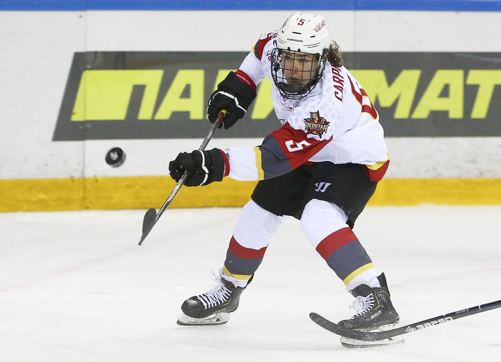 This photo provided by KHL-Marketing shows Alexandra Carpenter as she plays hockey for the KRS Vanke Rays on Oct. 15, 2019 in Ufa, Russia. Carpenter, ...