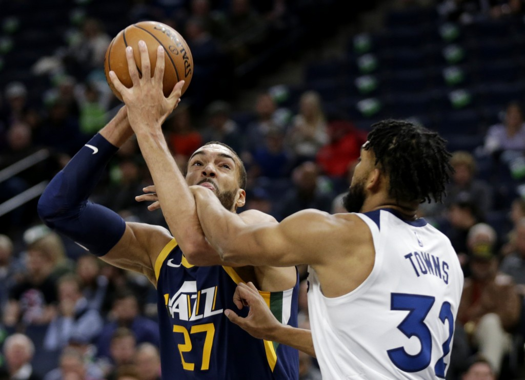 Utah Jazz center Rudy Gobert (27) is fouled by Minnesota Timberwolves center Karl-Anthony Towns (32) in the first quarter of an NBA basketball game We...