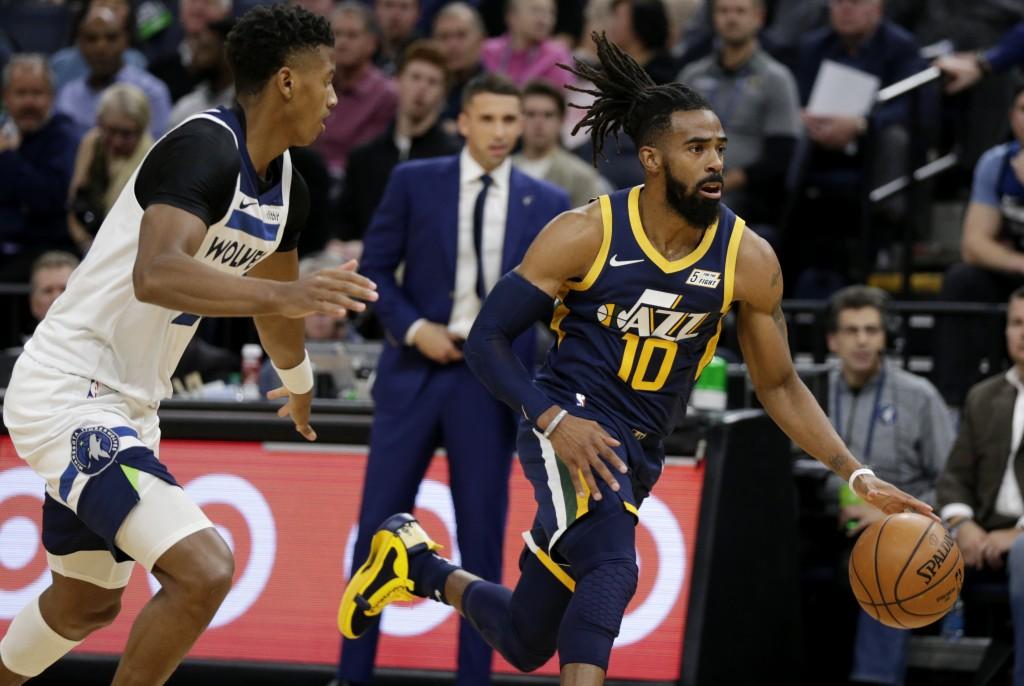 Utah Jazz guard Mike Conley (10) drives away from Minnesota Timberwolves guard Jarrett Culver during the first quarter of an NBA basketball game Wedne...