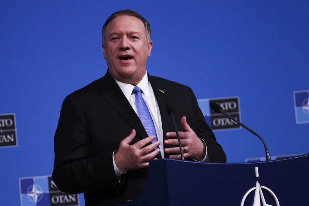 U.S. Secretary of State Mike Pompeo talks to journalists during a news conference during a NATO Foreign Ministers meeting at the NATO headquarters in ...