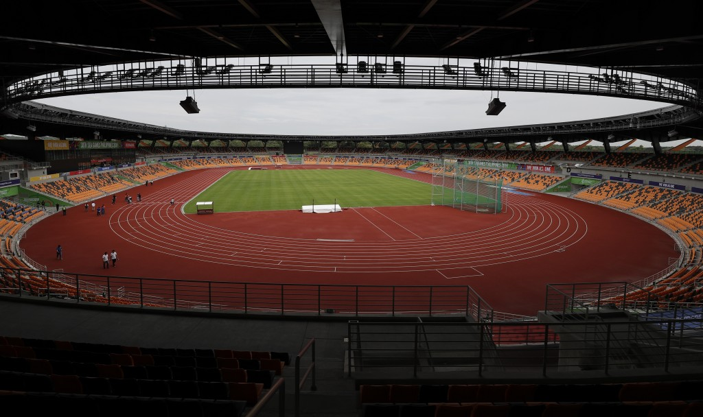 Visitors walk inside the newly built Athletics Stadium as they prepare for the 30th South East Asian Games at the New Clark City, Tarlac province, nor...