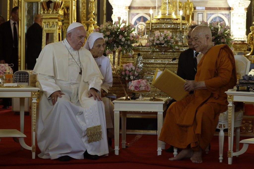 Pope Francis, left, and his cousin, Sister Ana Rosa Sivori visit the Supreme Buddhist Patriarch at Was Ratchabophit Sathit Maha Simaram Temple, Thursd...