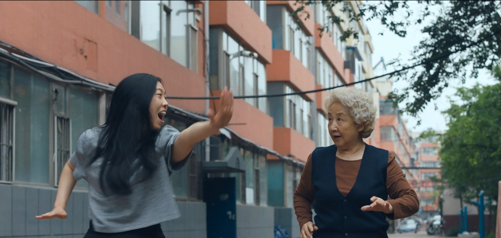 "This image released by A24 films shows Zhao Shuzhen, right, and Awkwafina in a scene from ""The Farewell."" (A24 via AP)"
