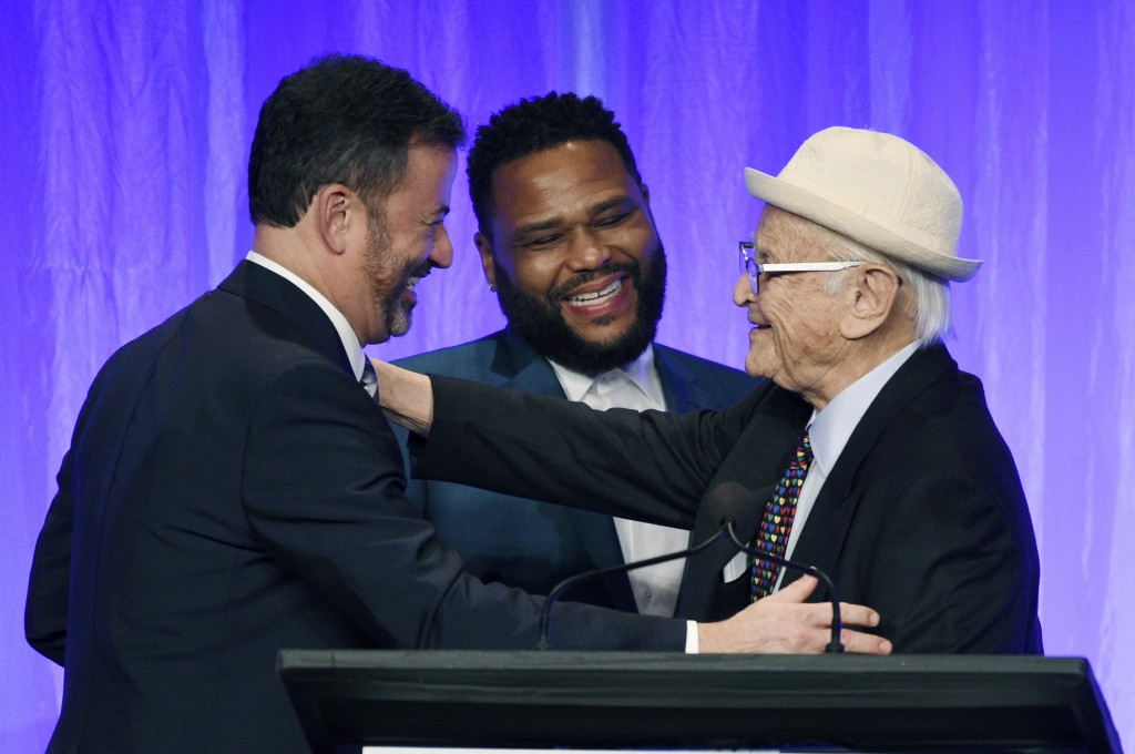 "Honoree Norman Lear, right, is congratulated by presenters Jimmy Kimmel, left, and Anthony Anderson onstage at ""The Paley Honors: A Special Tribute to..."
