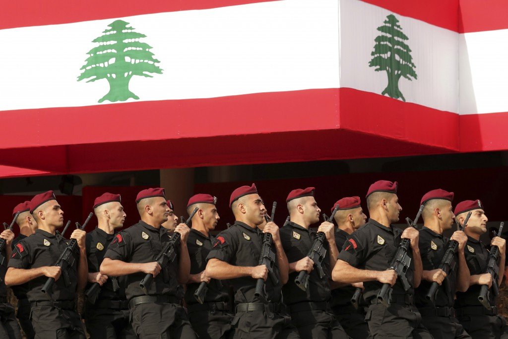 Lebanese marine special forces soldiers march during a military parade to mark the 76th anniversary of Lebanon's independence from France at the Leban...