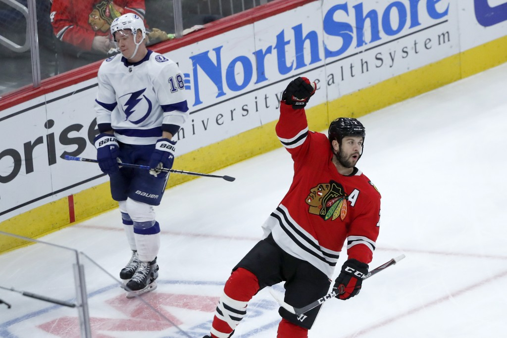 Chicago Blackhawks' Brent Seabrook, right, celebrates his goal as Tampa Bay Lightning's Ondrej Palat skates by during the third period of an NHL hocke...