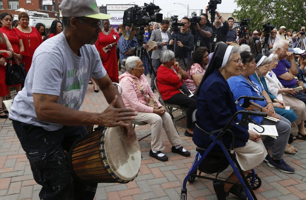 Hasan Smith plays a drum to welcome Catholic Cardinal Blase Cupich, of the Archdiocese of Chicago, to the city's Chicago Lawn neighborhood, June 6, 20...