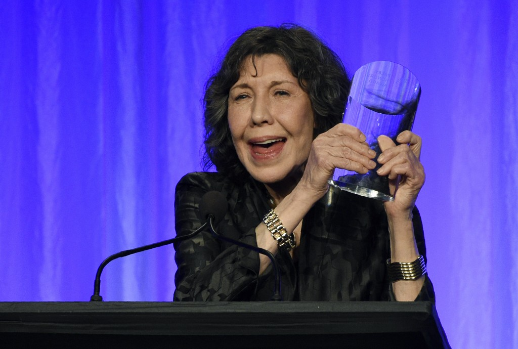 "Honoree Lily Tomlin holds her award onstage at ""The Paley Honors: A Special Tribute to Television's Comedy Legends"" at the Beverly Wilshire Hotel, Thu..."