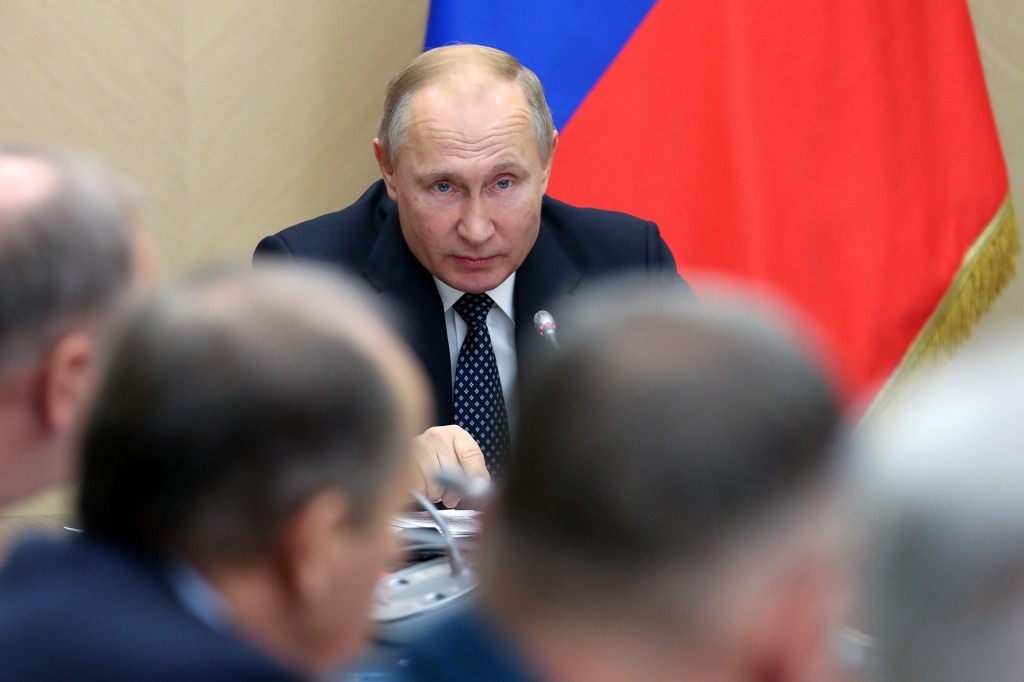 Russian President Vladimir Putin chairs a Security Council meeting at the Novo-Ogaryovo residence outside Moscow, Russia, Friday, Nov. 22, 2019. (Yeka...